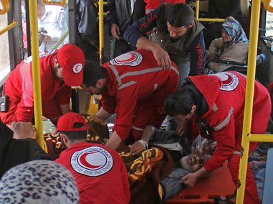 A Syrian man who arrived a day earlier from government-held Fuaa and Kafraya receives treatment by members of the Red Crescent.