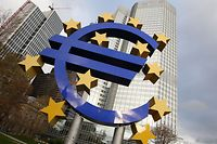 The Euro logo can be seen outside the European Central Bank, (ECB) before the meeting of the Governing Council in Frankfurt am Main, central Germany, on November 7, 2013. The ECB, after cutting its key interests rates, still has other weapons up its sleeve to boost recovery in the euro, Mario Draghi, President of the ECB said. AFP PHOTO / DANIEL ROLAND