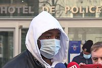 This tv grab taken on November 26, 2020 from an AFP video shows French music producer, identified only as Michel, talking to the media outside the IGPN (France's National Police General Inspectorate) as he arrives to press charges after he was repeatedly beaten by police forces as he tried to enter a music studio in the 17th district of Paris on November 21, 2020. - French authorities on November 26, 2020 opened an investigation and ordered suspensions of police after they were filmed beating up a black music producer in central Paris in images that sparked new anger over the conduct of the security forces. (Photo by Aurore MESENGE / AFP)