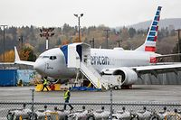 Boeing 737 MAX airliner with American Airlines markings is pictured on the ramp at Renton Airport adjacent to the Boeing Renton Factory in Renton, Washington on November 10, 2020. - Boeing said November 10, 2020 it was hit with another 12 cancelled orders for the 737 MAX, as the flagship aircraft is close to returning to the skies after being grounded since March 2019 following two deadly crashes. (Photo by Jason Redmond / AFP)
