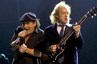 "AC/DC singer Brian Johnson (L) and lead guitarist Angus Young perform at the Thomas & Mack Center in Las Vegas September 14, 2000. The band is touring in support of the album ""Stiff Upper Lip."" REUTERS/Ethan Miller"