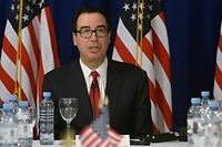 """US Treasury Secretary Steven Mnuchin speaks during a briefing with the press in Buenos Aires, on July 21, 2018 in the framework of the G20 meeting of Finance Ministers and Central Bank Governors. Mnuchin said he will be pushing China and the EU to agree to a more """"balanced"""" relationship on trade when he meets with finance ministers at the Group of 20 convention in Buenos Aires. / AFP PHOTO / STR"""