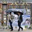 Britain's Prince William, Duke of Cambridge and Britain's Prince Harry walk away after looking at tributes left by members of the public at one of the entrances of Kensington Palace to mark the coming 20th anniversary of the death of Diana, Princess of Wales, in London on August 30, 2017. Princes William and Harry prepared to pay tribute to their late mother Princess Diana on Wednesday for the 20th anniversary of her death as wellwishers left candles and flowers outside the gates of her former London residence. The Princes visited the Sunken Garden in the grounds of Kensington Palace, which this year has been transformed into a White Garden, dedicated to their late mother, Britain's Diana, Princess of Wales. / AFP PHOTO / POOL / Kirsty Wigglesworth