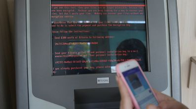 A message demanding money is seen on a monitor of a payment terminal at a branch of Ukraine's state-owned bank Oschadbank.