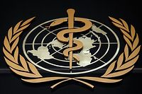 """(FILES) This file photo taken on February 24, 2020 shows the logo of the World Health Organization (WHO) written in French and Chinese at the entrance of their headquarters in Geneva. - President Donald Trump has formally withdrawn the United States from the World Health Organization, making good on threats over the UN body's response to the coronavirus, a senator said July 7, 2020.  """"Congress received notification that POTUS officially withdrew the US from the @WHO in the midst of a pandemic,"""" Senator Robert Menendez, the top Democrat on the Foreign Relations Committee, wrote on Twitter. (Photo by Fabrice COFFRINI / AFP)"""