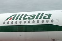 (FILES) This file photo taken on April 28, 2017 shows a plane of the Italian airline company Alitalia parked at Rome's Fiumicino airport. Shareholders in Alitalia voted unanimously on May 2, 2017 to put the company into administration, moving the troubled airline a step closer to liquidation as efforts continue to find a buyer.The move follows last week's rejection by staff of job and salary cuts which management had proposed as a condition for injecting new funds under a two-billion-euro rescue plan for the loss-making company. / AFP PHOTO / Tiziana FABI