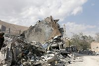 "This picture taken on April 14, 2018 shows the wreckage of a building described as part of the Scientific Studies and Research Centre compound in the Barzeh district, north of Damascus, during a press tour organised by the Syrian information ministry. The United States, Britain and France launched strikes against Syrian President Bashar al-Assad's regime early on April 14 in response to an alleged chemical weapons attack after mulling military action for nearly a week. Syrian state news agency SANA reported several missiles hit a research centre in Barzeh, north of Damascus, ""destroying a building that included scientific labs and a training centre"". / AFP PHOTO / Louai Beshara"