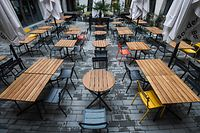 A view shows empty chairs and tables at a restaurant in the pedestrian area in Cologne, western Germany on January 4, 2021 amid the ongoing novel coronavirus / COVID-19 pandemic. - German Chancellor Angela Merkel and state leaders are expected Tuesday, January 5, 2021 to extend a partial lockdown in Europe's top economy as coronavirus deaths continue to mount despite tough restrictions in the run-up to the holidays. (Photo by Ina FASSBENDER / AFP)