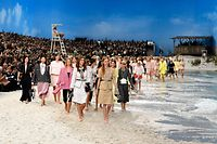 Models present creations by Chanel at the end of the Spring-Summer 2019 Ready-to-Wear collection fashion show at the Grand Palais in Paris, on October 2, 2018. (Photo by Bertrand GUAY / AFP)