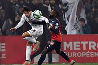 Lille's French forward Jonathan Ikone (R) vies with Metz's French defender Fabien Centonze during the French L1 football match between Lille (LOSC) and FC Metz at the Pierre-Mauroy Stadium in Villeneuve d'Ascq, near Lille, northern France, on  November 09 2019. (Photo by DENIS CHARLET / AFP)