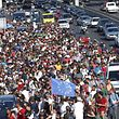 Migrants march along the highway towards the border with Austria, out of Budapest, Hungary, September 4, 2015. Hundreds of migrants broke out of a Hungarian border camp on Friday and others set off on foot from Budapest as authorities scrambled to contain a migrant crisis that has brought Europe's asylum system to breaking point. Hungary says it is enforcing European Union rules that it must register all migrants caught crossing Hungary's borders, but thousands are refusing and demand they be allowed to continue their journey to western Europe from war and poverty in the Middle East, Africa and Asia. The European Union normally allows free movement between the 26 countries of its Schengen border-free zone, but its rules require asylum seekers to register in the first country where they arrive and remain until they are processed.        REUTERS/Laszlo Balogh