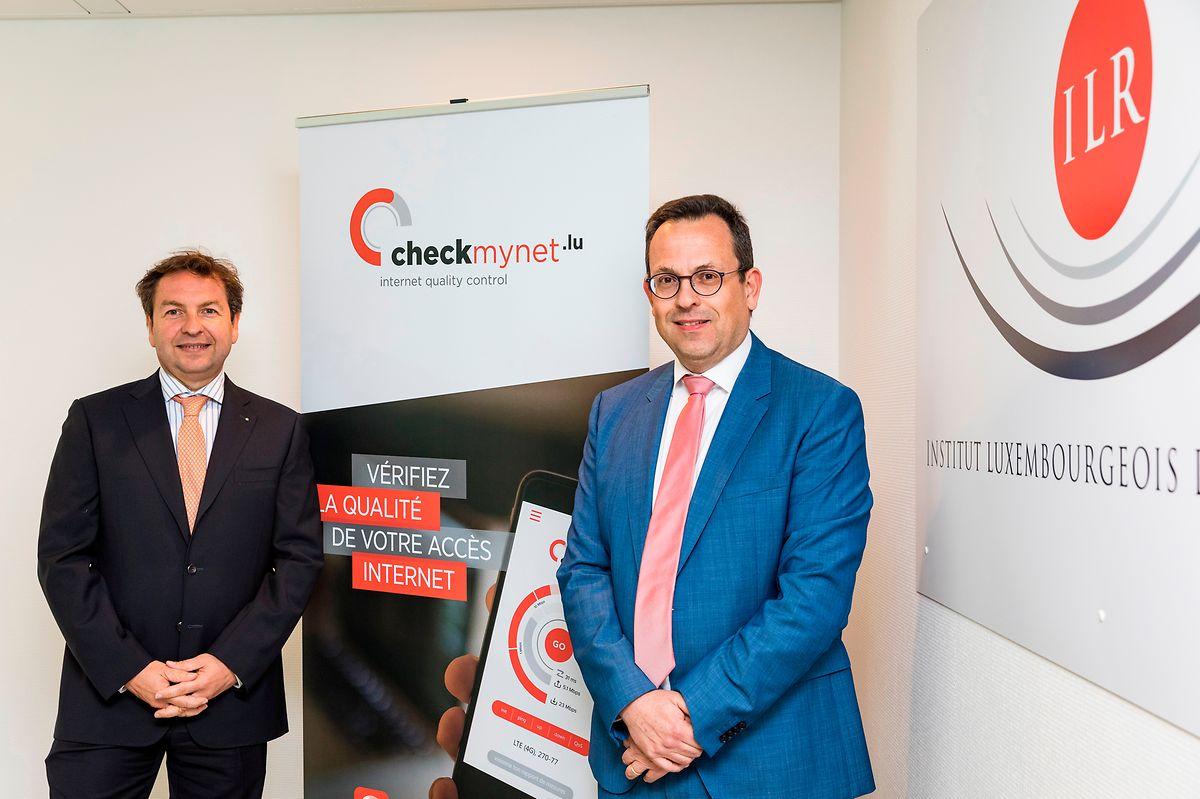 """ILR-Chef Luc Tapella (l.) mit Tom Mannes, zuständig für die Regulierung der elektronischen Kommunikation beim ILR: Die Test-Software """"checkmynet"""" wird häufig genutzt, weltweit sogar."""