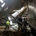 HOBOKEN, NJ - SEPTEMBER 29: Train personel survey the NJ Transit train that crashed in to the platform at the Hoboken Terminal September 29, 2016 in Hoboken, New Jersey.   Pancho Bernasconi/Getty Images/AFP == FOR NEWSPAPERS, INTERNET, TELCOS & TELEVISION USE ONLY ==