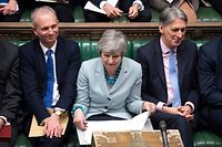 "A handout photograph released by the UK Parliament shows Britain's Minister for the Cabinet Office and Chancellor of the Duchy of Lancaster David Lidington (L), Britain's Prime Minister Theresa May (C) and Britain's Chancellor of the Exchequer Philip Hammond (R) listening to questions in the House of Commons in London on March 25, 2019 on the next steps that parliament will take in the Brexit process. - Prime Minister Theresa May admitted Monday she had still not secured the votes needed to get her Brexit deal through parliament, raising again the prospect that Britain could crash out of the European Union in two weeks' time. (Photo by Jessica TAYLOR / UK PARLIAMENT / AFP) / RESTRICTED TO EDITORIAL USE - NO USE FOR ENTERTAINMENT, SATIRICAL, ADVERTISING PURPOSES - MANDATORY CREDIT "" AFP PHOTO /JESSICA TAYLOR/ UK Parliament"""