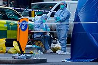 A forensics officer works outside a tent on Cannon Street near London Bridge in the City of London, on November 30, 2019, following the November 29 terror incident on London Bridge. - A man suspected of stabbing two people to death in a terror attack on London Bridge was an ex-prisoner convicted of terrorism offences and released last year, police said Saturday. (Photo by Niklas HALLE'N / AFP)