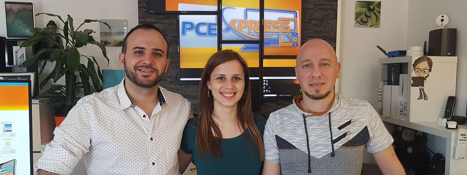 Esq p/ dta: Marco (gerente e técnico de informática), Cátia (administrativa e atendimento cliente), Filipe (técnico de telemóveis)