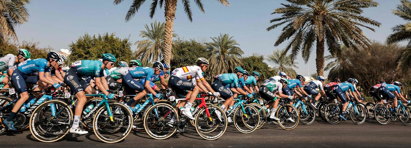 The pack rides during the third stage of the UAE Cycling Tour from Al Ain to Jebel Hafeet on February 23, 2021. (Photo by GIUSEPPE CACACE / AFP)