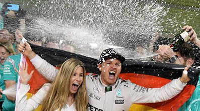 Nico Rosberg won his maiden Formula One world title by securing second place behind his Mercedes arch-rival Lewis Hamilton in the Abu Dhabi Grand Prix