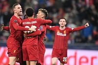 Liverpool's team celebrates after scoring during the UEFA Champions League Group E football match between RB Salzburg and Liverpool FC on December 10, 2019 in Salzburg, Austria. (Photo by JOE KLAMAR / AFP)
