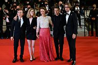 """(FromL) British actor Tim Roth, French director Mia Hansen-Love, Luxembourg actress Vicky Krieps, Norwegian actor Anders Danielsen Lie and Swedish actor Hampus Nordenson pose as they arrive for the screening of the film """"Bergman Island"""" at the 74th edition of the Cannes Film Festival in Cannes, southern France, on July 11, 2021. (Photo by Christophe SIMON / AFP)"""