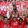Benfica soccer players celebrate with the trophy after their victory against Maritimo in the end of the Portuguese League Cup final held at Cidade de Coimbra Stadium, Coimbra, Portugal, 29 May 2015.  JOSE COELHO/LUSA