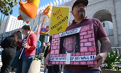 People protest against U.S. President Donald Trump's National Emergency declaration, February 18, 2019, outside City Hall in Los Angeles, California. - The event is part of a nationwide mobilization in response to Trumps's invoking of a national emergency to receive more funding for a border wall along the U.S.-Mexico border. (Photo by Robyn Beck / AFP)