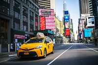 NEW YORK, NY - MARCH 26: A taxi drives down Times Square on March 26, 2020 in New York City. Most cabdrivers are fearful of being exposed to the coronavirus that they prefer to stay home with no way to pay bills, while across the country schools, businesses and places of work have either been shut down or are restricting hours of operation as health officials try to slow the spread of COVID-19.   Eduardo Munoz Alvarez/Getty Images/AFP == FOR NEWSPAPERS, INTERNET, TELCOS & TELEVISION USE ONLY ==