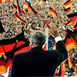 FILE PHOTO -  German Chancellor Helmut Kohl gestures during an electoral rally in Erfurt for first free elections in East Germany in this February 1990 file photo. REUTERS/Michael Urban/File Photo