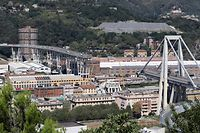 This general view taken on August 15, 2018, shows abandoned vehicles on the Morandi motorway bridge the day after a section collapsed in the north-western Italian city of Genoa. - At least 38 people were killed on August 14, when the giant motorway bridge collapsed in Genoa in northwestern Italy. The collapse, which saw a vast stretch of the A10 freeway tumble on to railway lines in the northern port city, was the deadliest bridge failure in Italy for years, and the country's deputy transport minister warned the death toll could climb further. (Photo by Valery HACHE / Piero CRUCIATTI / AFP / AFP)