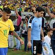 Football Soccer - Brazil v Uruguay - World Cup Qualifiers - Arena Pernambuco stadium - Recife, Brazil- 25/3/16 - Luis Suarez (9) of Uruguay and Neymar of Brazil. REUTERS/Paulo Whitaker