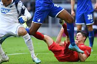 Bayern Munich's Polish forward Robert Lewandowski falls during the German first division Bundesliga football match FC Bayern Munich vs TSG 1899 Hoffenheim in Munich, southern Germany, on October 5, 2019. (Photo by Christof STACHE / AFP) / DFL REGULATIONS PROHIBIT ANY USE OF PHOTOGRAPHS AS IMAGE SEQUENCES AND/OR QUASI-VIDEO
