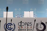 Empty chairs are pictured on the last day of the UN Climate Change Conference COP25 at the 'IFEMA - Feria de Madrid' exhibition centre, in Madrid, on December 13, 2019. - The preservation of Earth's pristine wildernesses and oceans, long treated as a separate issue to curbing climate change, is taking on more importance as scientists say they really need to go hand in hand. While the focus at COP25 in Madrid these past two weeks has been on climate change and the growing urgency to cut greenhouse gas emissions, organisers have made an effort to put the natural environment into the mix. (Photo by CRISTINA QUICLER / AFP)