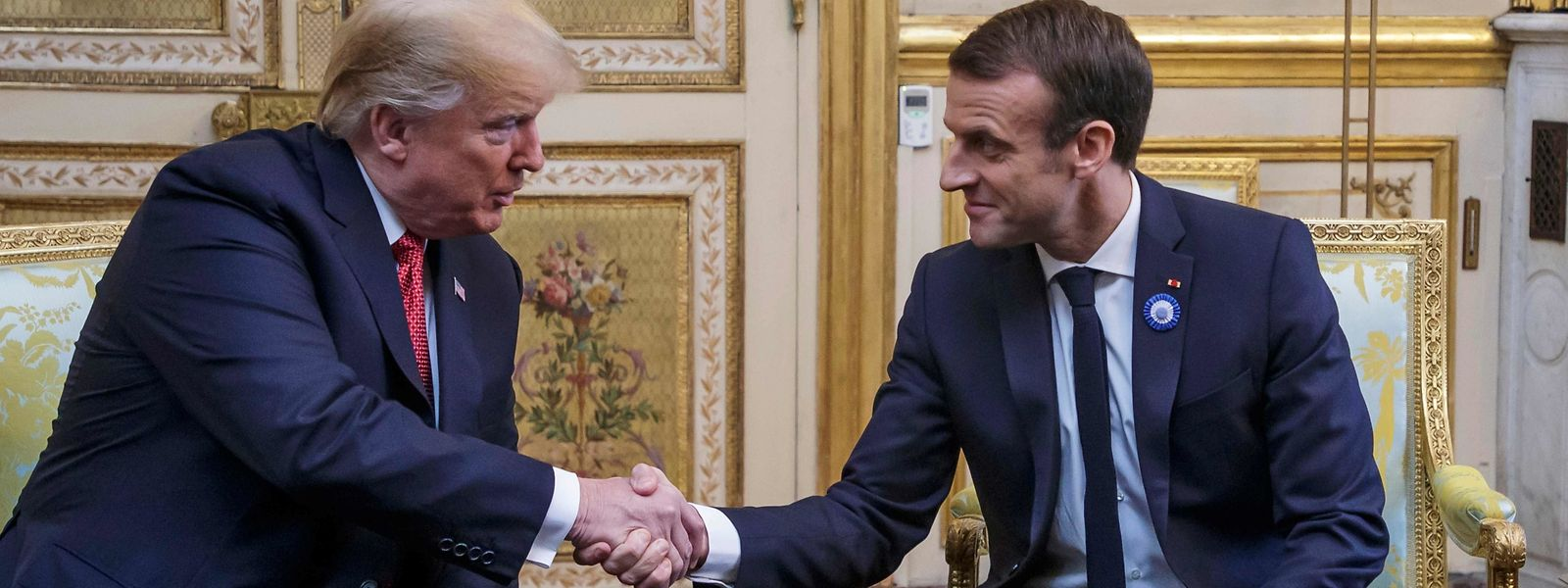 US President Donald Trump (L) shakes hands with French president Emmanuel Macron prior to their meeting at the Elysee Palace in Paris, on November 10, 2018, on the sidelines of commemorations marking the 100th anniversary of the 11 November 1918 armistice, ending World War I. (Photo by Christophe Petit-Tesson / POOL / AFP)