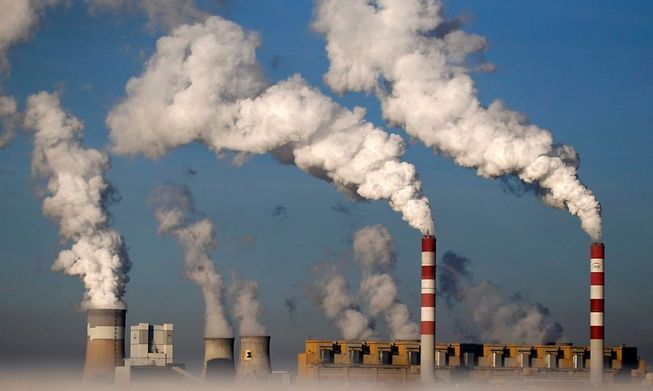 Smoke billows from the chimneys of the Belchatow Power Station in Poland, Europe's largest coal-fired power plant