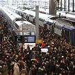 Commuters stand on a crowded platform of the Gare de Lyon railway station on April 3, 2018 in Paris, on the first day of a two days strike. Staff at state rail operator SNCF walked off the job from 7.00 pm (1700 GMT) on April 2, the first in a series of walkouts affecting everything from energy to garbage collection. The rolling rail strikes, set to last until June 28, are being seen as the biggest challenge yet to the President's sweeping plans to shake up France and make it more competitive. / AFP PHOTO / ludovic MARIN