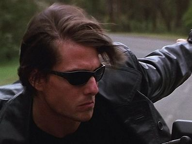 Tom Cruise in Mission Impossible shooting with the aid of spy glasses