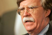 John Bolton, the U.S. ambassador to the United Nations, talks to the press as he arrives for consultations at U.N. headquarters in New York Wednesday July 5, 2006. Even with Japan and the United States pressing for a U.N. Security Council meeting early Wednesday in New York on the issue of North Korea's test-firing of a stream of missiles Wednesday, few people expected members to take immediate harsh action. (AP Photo/Seth Wenig)