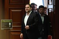 (FILES) In this file photo taken on May 20, 2019 Catalonia's former vice-president and elected member of parliament Oriol Junqueras (L) smiles inside the Parliament building in Madrid on May 20, 2019, after being temporarily released to register as MP. - Twelve Catalan separatist leaders, most of them members of the former regional government, were convicted by Spain's Supreme Court on October 14, 2019 for their role in a controversial independence bid in 2017. Oriol Junqueras, who became the main defendant after former Catalan president Carles Puigdemont fled to Belgium to avoid prosecution, was handed a 13-year jail term for sedition and misuse of public funds. (Photo by PIERRE-PHILIPPE MARCOU / AFP)