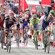 "Orica Bikeexchange's Norwegian cyclist Magnus Cort Nielsen (R) celebrates winning as he crosses the finish line during the 18th stage of the 71st edition of ""La Vuelta"" Tour of Spain, a 191km route Requena to Gandia, on September 8, 2016. / AFP PHOTO / JOSE JORDAN"