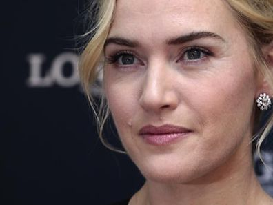 British actress Kate Winslet attends the opening of a Longines flagship store in Hong Kong December 9, 2012. REUTERS/Bobby Yip (CHINA - Tags: ENTERTAINMENT BUSINESS PROFILE)