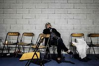 A woman waits in a gymnasium in Le Teil, southeastern France, on November 11, 2019, after an earthquake with a magnitude of 5.4 hit the area. - An unusually strong earthquake hit southeastern France on November 11, 2019, injuring four people, one of them seriously, authorities said. The quake, with a magnitude of 5.4, was felt in a vast area between the cities of Lyon and Montelimar which are about 150 kilometres (93 miles) apart, the national seismological office said. (Photo by JEFF PACHOUD / AFP)