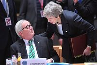 President of the European Commission Jean-Claude Juncker (L) talks to Britain's Prime Minister Theresa May as she arrives to attend a European Summit aimed at discussing the Brexit deal, the long-term budget and the single market on December 13, 2018 in Brussels. - The 27 European leaders gather for a crucial European Union summit with the British Prime Minister seeking a compromise to save the Brexit deal. (Photo by EMMANUEL DUNAND / AFP)