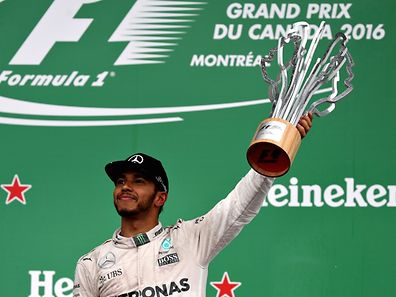 Lewis Hamilton of Great Britain and Merccedes GP celebrates his win on the podium during the Canadian Formula One Grand Prix