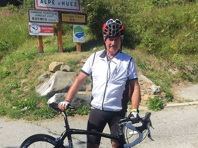 Luxembourg Foreign Affairs Minister Jean Asselborn pedalled to the peak of the Alpe d'Huez during his summer holiday