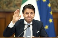 "(FILES) In this file handout photo taken on November 19, 2020,  in Rome oand released by the Italian Prime Minister's press office, Prime Minister Giuseppe Conte waves during a video conference meeting with members of the European Council on the EU response to the COVID-19 pandemic. - Italian Prime Minister Giuseppe Conte will resign January 26, 2021, his office said on January 25, 2021, in what media reports said was a move to secure a mandate for a new government after weeks of turmoil. A statement from Conte's office said he had called a cabinet meeting for 9:00am (0800 GMT) ""during which the prime minister, Giuseppe Conte, will inform the ministers of his desire to go to the Quirinale (President Sergio Mattarella's office) to resign"". (Photo by - / Italian Prime Minister's Press Office / AFP)"