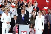 Polish President Andrzej Duda addresses supporters as exit poll results were announced during the presidential election in Pultusk, Poland, on July 12, 2020. - Poland's right-wing head of state Andrzej Duda was ahead by a tiny margin in the presidential run-off against Warsaw's liberal mayor, an exit poll on on July 12, 2020 showed, starting a tense wait for the official results (Photo by JANEK SKARZYNSKI / AFP)