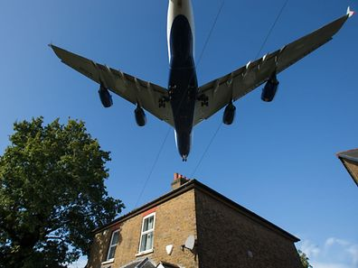 (FILES) This file photo taken on October 17, 2016 shows passenger aircraft preparing to land at London Heathrow Airport in west London. The UK government has confirmed on October 25, 2016 that it backs the expansion of London's Heathrow Airport. / AFP PHOTO / Daniel Leal-Olivas
