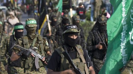 Palestinian militants from the Ezzedine al-Qassam Brigades, the armed wing of the Palestinian Hamas movement, take part in a military parade against Israel in Gaza City on July 25, 2017