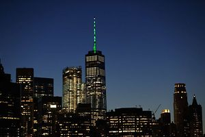 NEW YORK, NY - JUNE 1: As directed by New York Governor Andrew Cuomo in response to President Donald Trump's decision to pull the United States out of the Paris Climate Accord, One World Trade Center is illuminated with green light, June 1, 2017 in New York City. Trump pledged on the campaign trail to withdraw from the accord, which former President Barack Obama and the leaders of 194 other countries signed in 2015. The agreement is intended to encourage the reduction of greenhouse gas emissions in an effort to limit global warming to a manageable level.  Drew Angerer/Getty Images/AFP