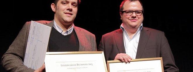 """Die beiden """"LW""""-Journalisten Eric Hamus (l.) und Steve Remesch dürfen sich über den Preis in der Kategorie Sachbuch freuen."""